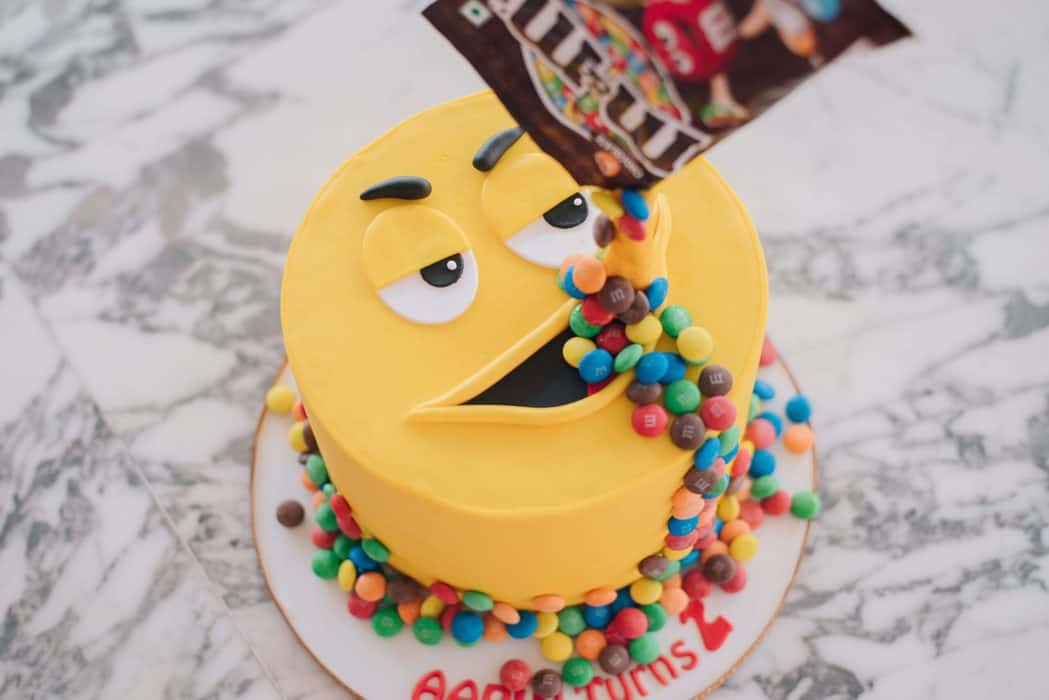 happy face emoji eating m and m irresistible offer