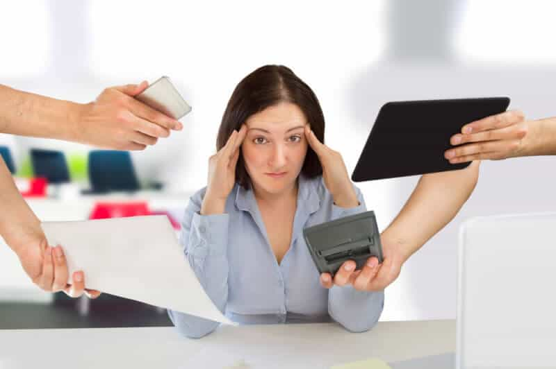 example of stock image from DepositPhotos - overwhelmed woman