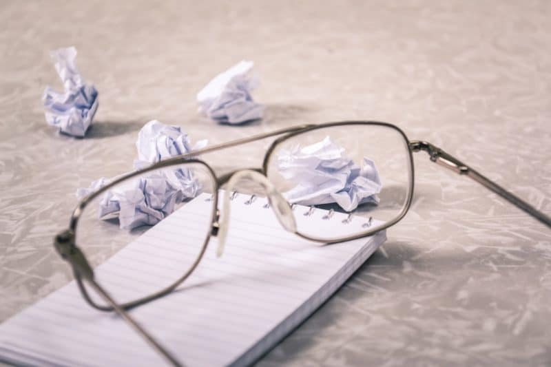 glasses with balled up paper to indicate customer frustration and use it to build your USP