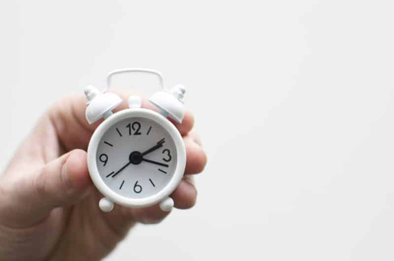 is it time to update your unique selling proposition. hand holding clock