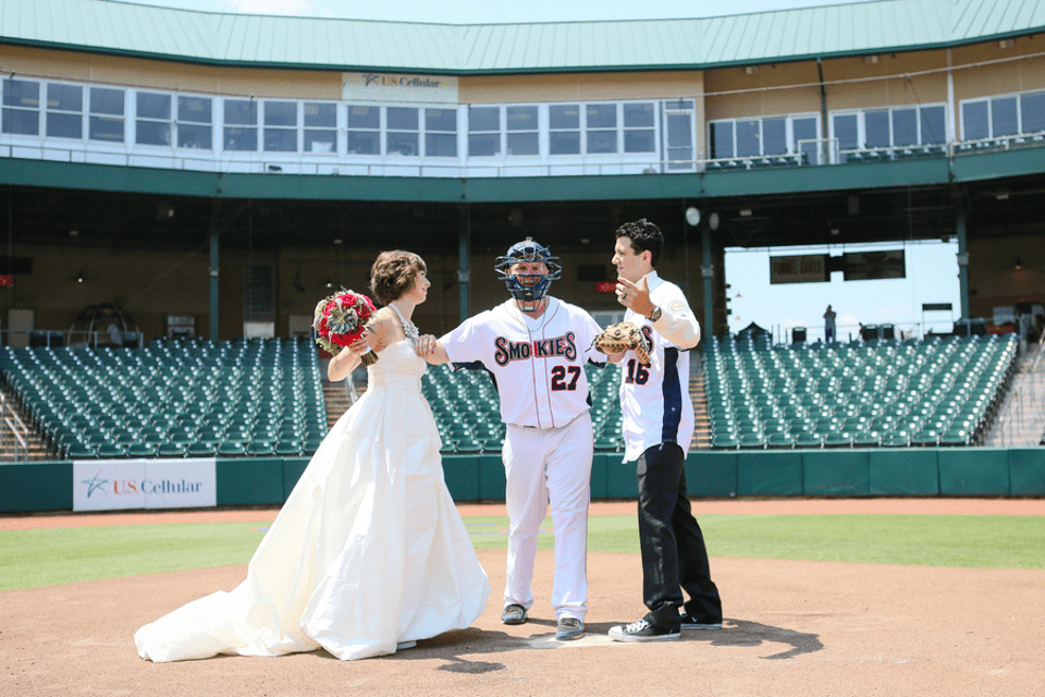 picture of a couple getting married on a baseball field