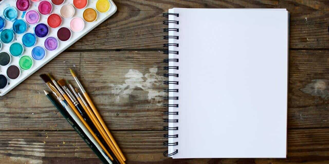 visual marketing notebook and paint