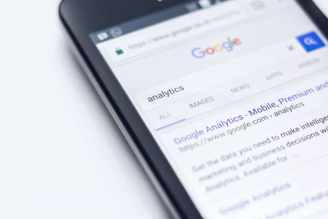mobile phone featuring google search for SEO